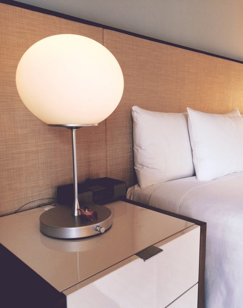 lamp. nightstand, bed
